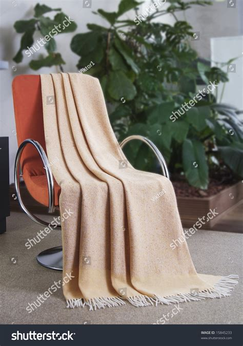 draped over blanket draped over a chair stock photo 15845233