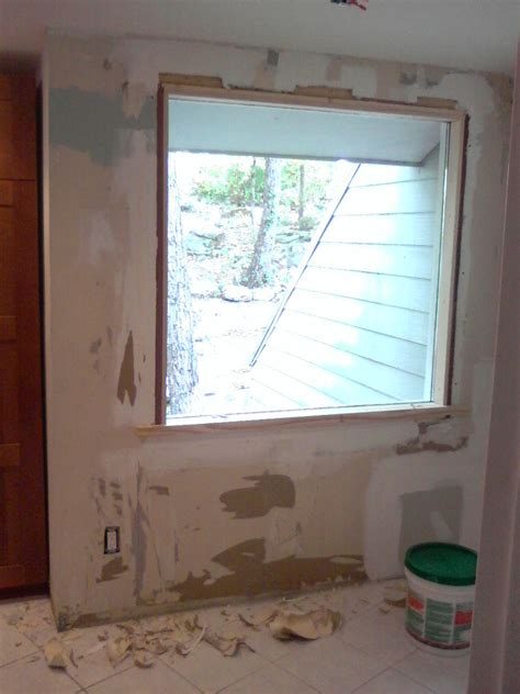 the birmingham handyman drywall repair around window
