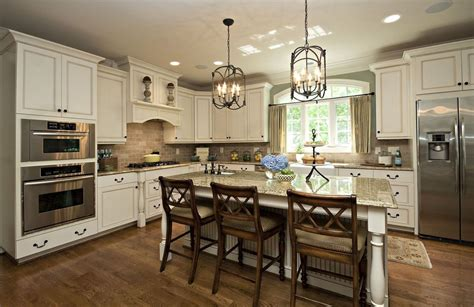 traditional kitchen with pendant light by driggs