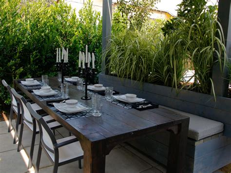 outdoor dining area with large rustic table and banquette