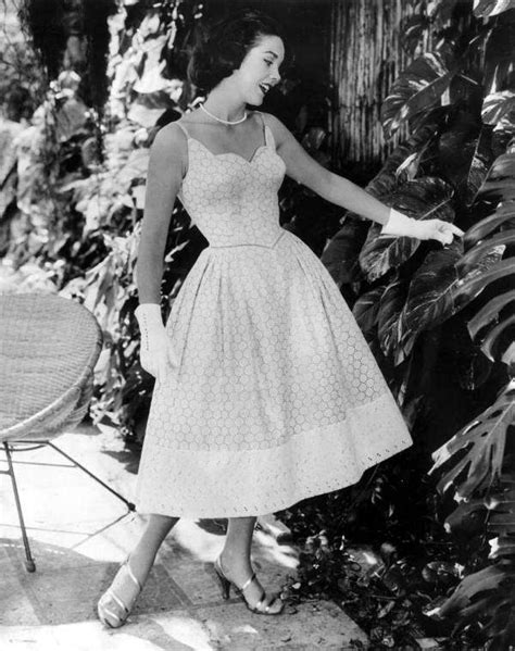 A model poses in a dress - Miami | Fashion, 1950 fashion