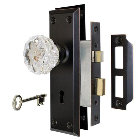 defiant 2 in aged bronze glass knob mortise set