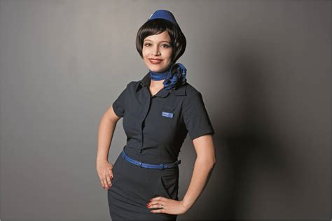 Airlie Tunic Black indigo goes for a chic and look in cabin crew makeover