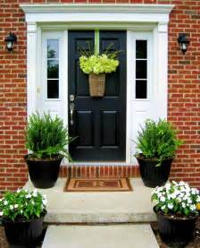 plants for outside front door stylish black front doors change your house s curb appeal