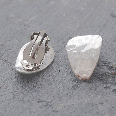 silver textured petal clip on earrings by otis jaxon