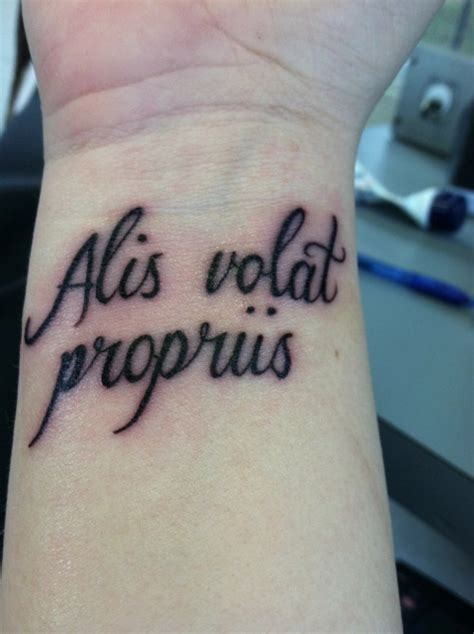 latin wrist tattoos quote