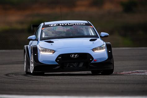 hyundai unveils veloster  tcr race car   detroit