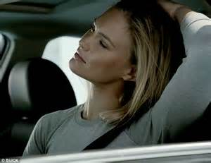 carbonite commercial actress blonde bar refaeli strikes poses with buick in caign for gm s