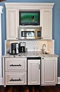 small beverage refrigerator with glass door kitchen microwave and coffee station love the location