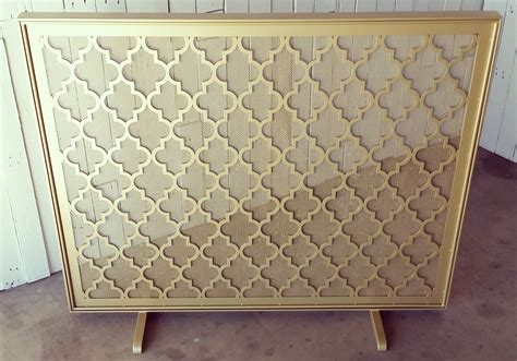 made quatrefoil metal fireplace screen by