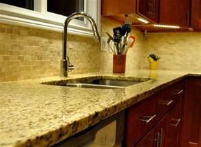 warm kitchen with giallo ornamental granite granite