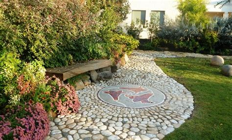made landscaping artist made mosaic integrate in a pebbles made path
