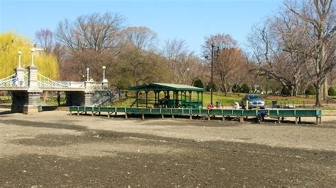 swan boats opening day 2018 first you spiff up the dock swan boats step one bostonzest
