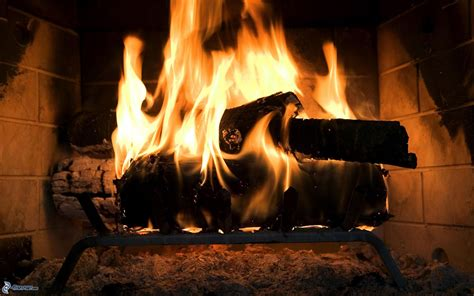Burning Wood In A Fireplace by Burning Wood
