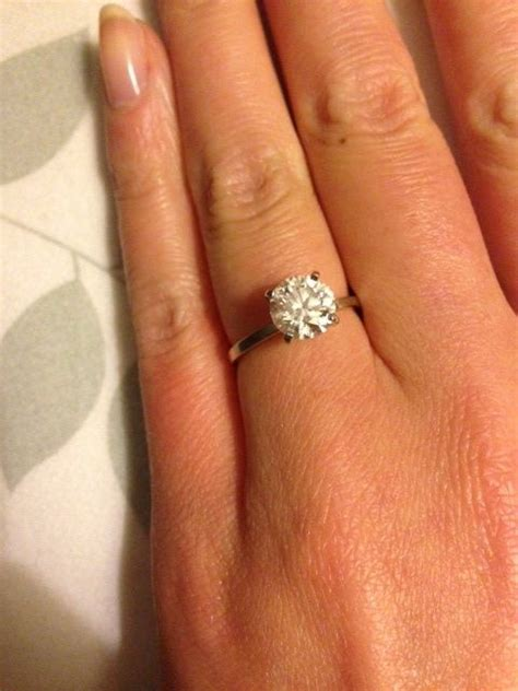 thin engagement ring band with solitaire