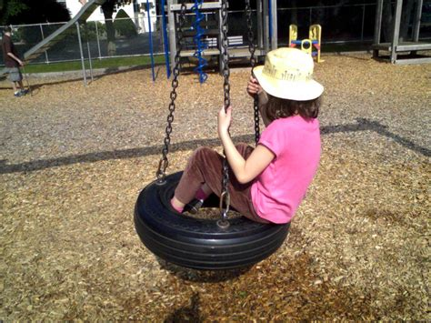 tire swings for kids file spinning tire swing with child jpg wikimedia commons