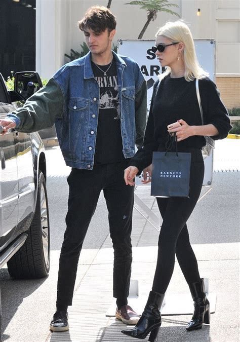 what type of sneakersdoes yolanda foster wear anwar hadid seen with nicola peltz rocking guess denim