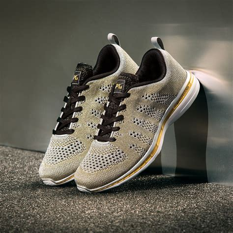 gold athletic shoes apl s running shoes techloom pro silver gold black