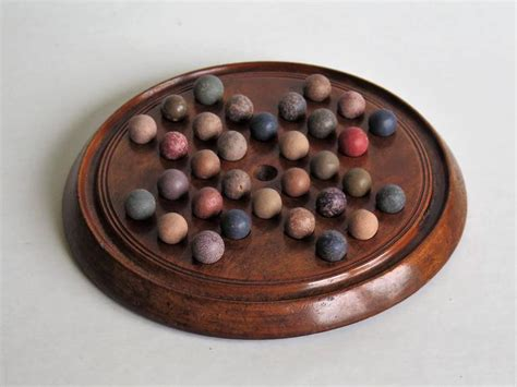 Handmade Marbles For Sale - mid 19th century solitaire marble board with 32 early