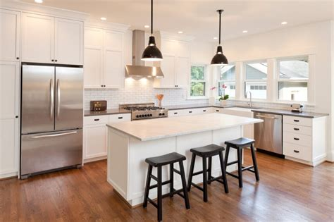 white kitchen cabinets dark wood floors cream tile top on the floor white dark wood floors black