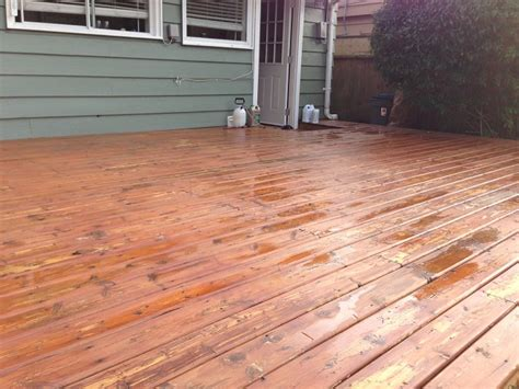 sand  entire deck  staining home