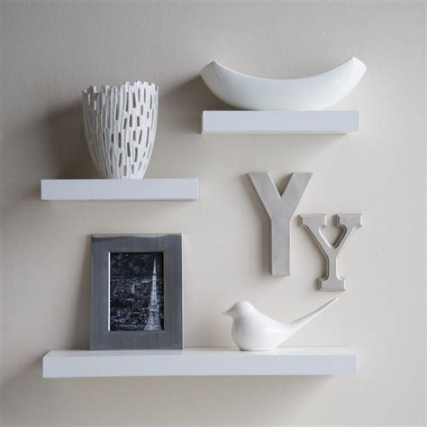 white small floating shelves on white wall design