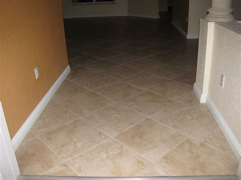 this floor was transformed from laminate to beautiful 24 x 24 inch rectified porcelain tile