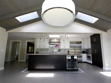 a large drum pendant light hangs from a vaulted ceiling in