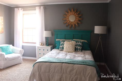 the handcrafted teal white and grey guest bedroom