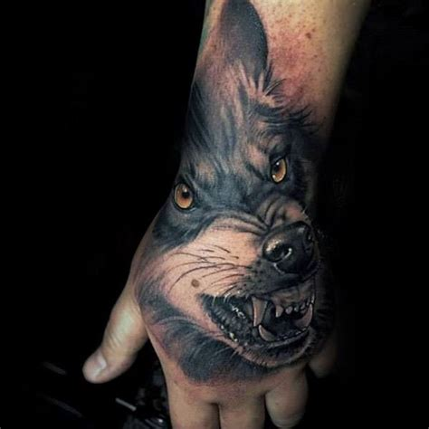 wolf hand tattoo 60 sick wolf designs for manly ink ideas