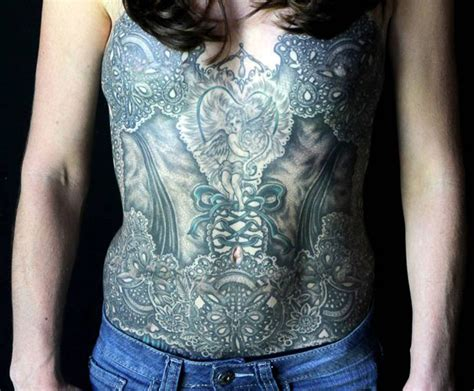 tattoo artists cover breast cancer survivors scars with