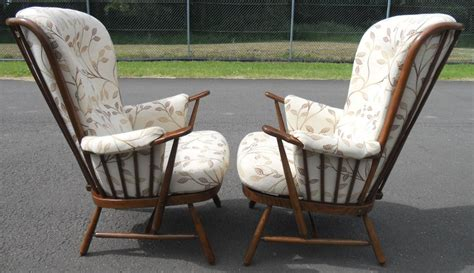 ercol armchairs sold pair upholstered armchairs by ercol