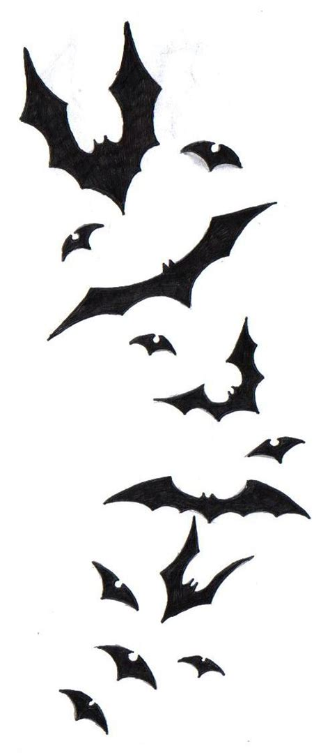 batman tattoo on back of shoulder with bats going over to bat tattoos and designs page 3
