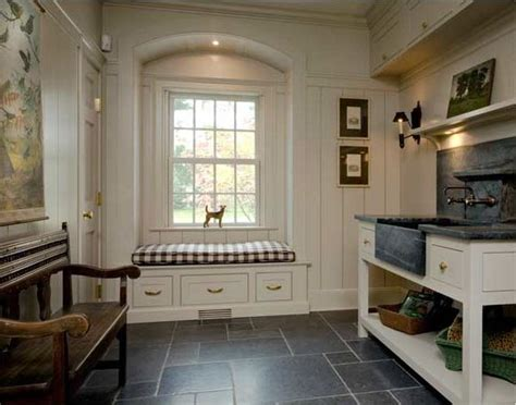 mudroom design soapstone farmhouse sink slate floors built in cabinetry