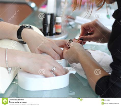 Getting A Manicure by Getting A Manicure Royalty Free Stock Photography