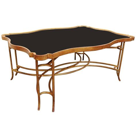 gilt iron coffee table with polished black granite top at