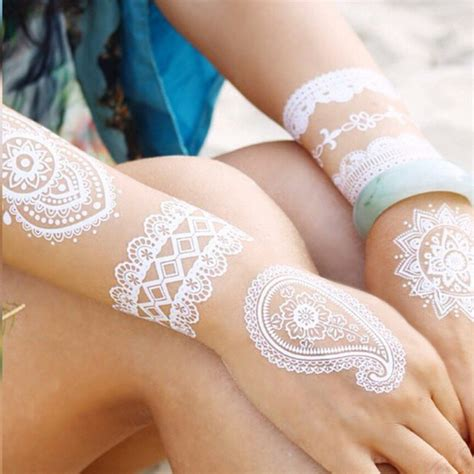 stunning white henna like tattoos look like lace draped