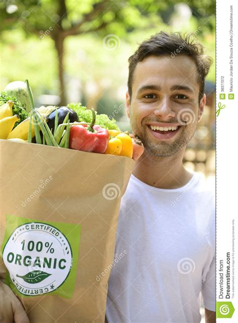 carrying bag of food happy carrying a bag of organic food stock photography image 38377072