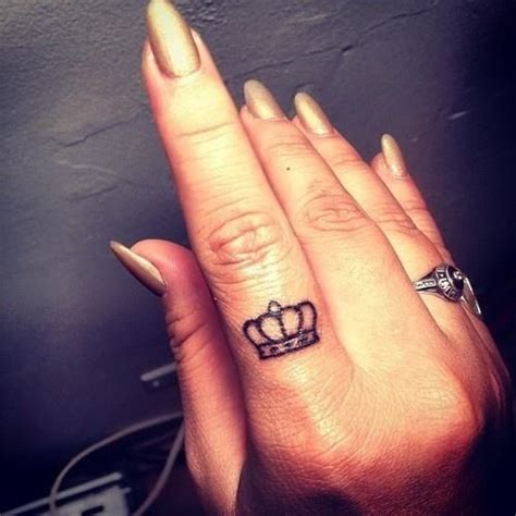 small tiara tattoo small crown on finger