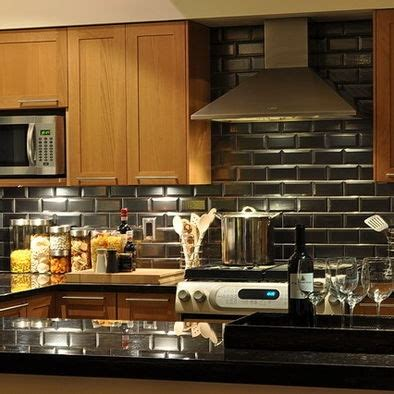 black subway tile kitchen backsplash for the home