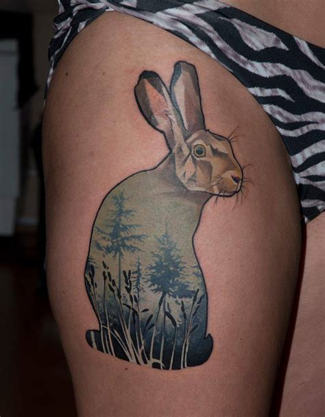unique rabbit tattoo on right thigh