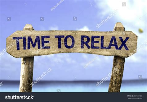 time with a time relax wooden sign on stock photo 227686159