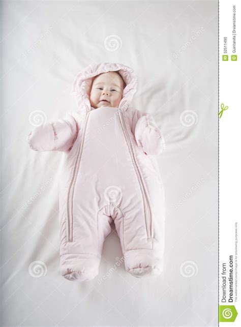 how to dress baby for bed pink snowsuit baby on bed stock photo image of people