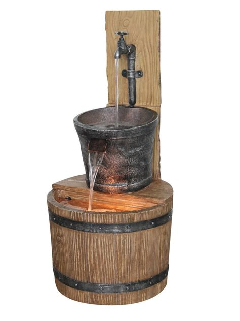 oak barrel with tap water feature by aqua creations