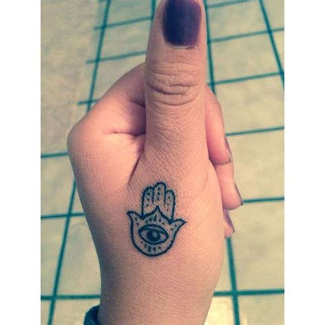 eye tattoo healing a tiny hamsa tattoo below the thumb ensures that its