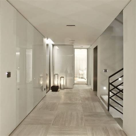 modern floor panels of glass perhaps on white walls and stunning stone