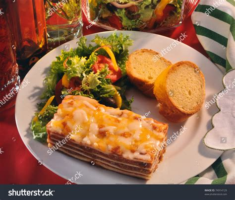 what to make with lasagna for dinner lasagna on dinner plate salad bread stock photo 74914129