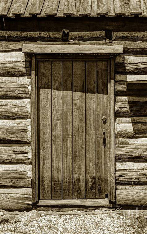 pioneer log cabin door up photograph by gary whitton