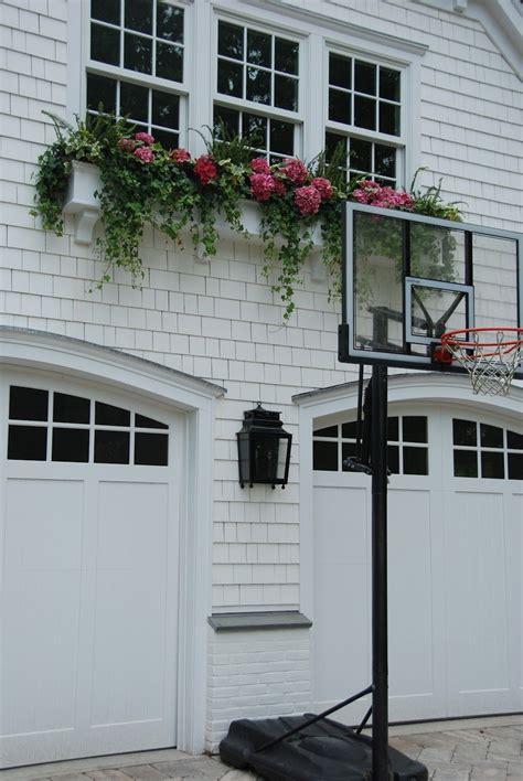 shaker siding pretty windows arched top garage doors