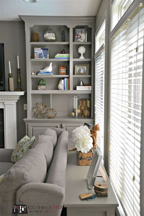 decor behind sofa how to style bookshelves living rooms room and shelves